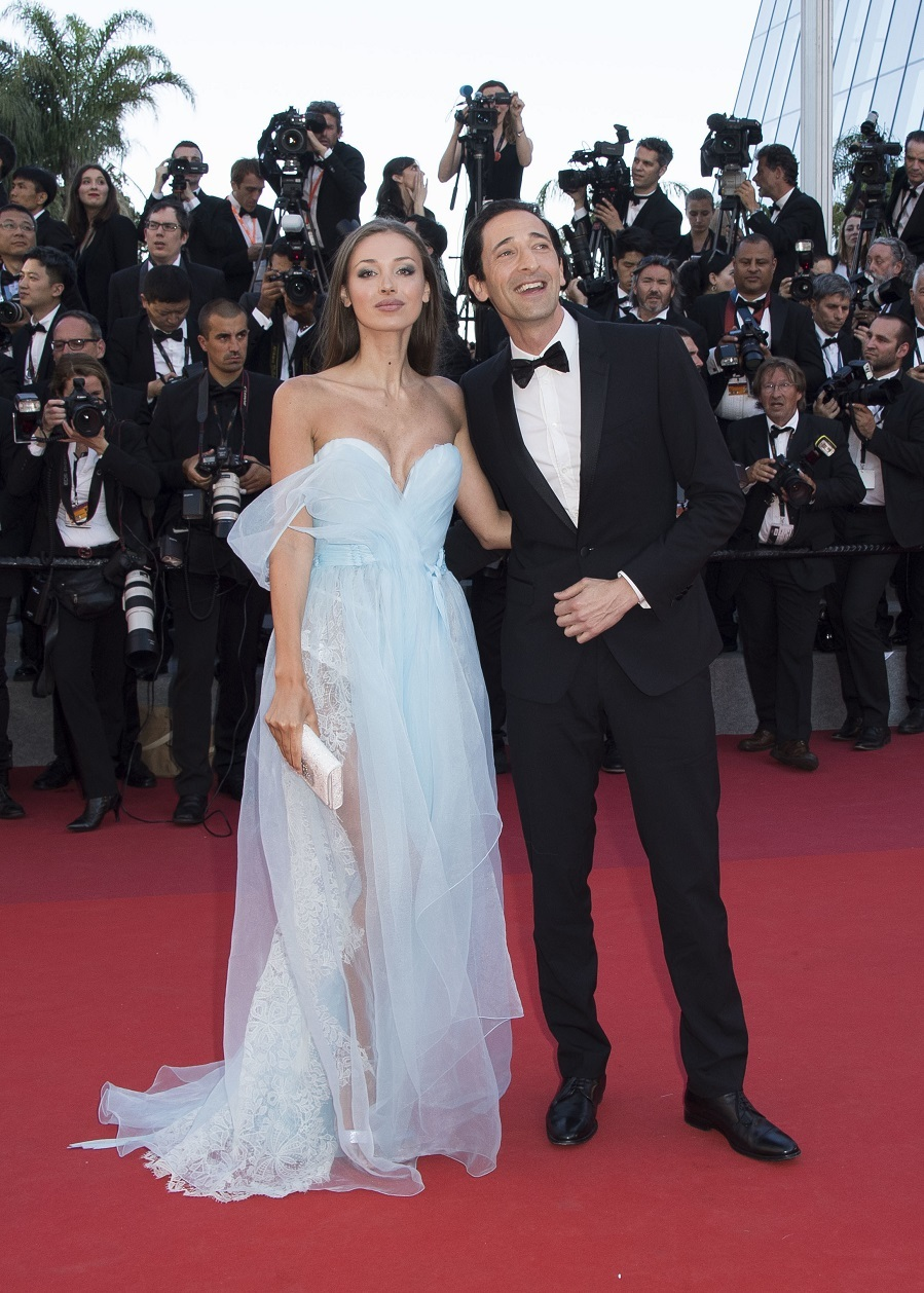 Lara Lieto, left, and Adrien Brody pose for photographers upon arrival at the opening ceremony and the screening of the film Ismael's Ghosts at the 70th international film festival, Cannes, southern France, Wednesday, May 17, 2017. (Photo by Arthur Mola/Invision/AP)
